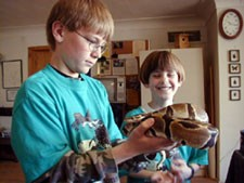 2 boys with snake